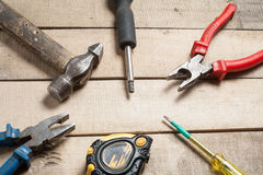 Construction tools on wooden background. Copy space for text. Set of assorted work tool at wood table . Top view. Construction tools on wooden background. Copy stock images