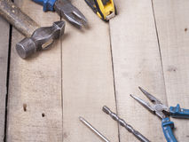 Construction tools on wooden background. Copy space for text. Set of assorted work tool at wood table . Top view Royalty Free Stock Photos
