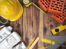Construction tools on a wooden background. Hard helmet, bricks, Stock Photos