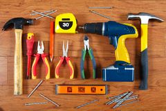 Construction tools on the wooden floor Royalty Free Stock Photography