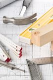 Construction tools and wooden strips on architectural blueprint house building plan stock image