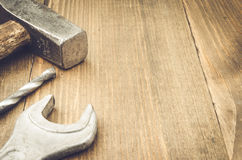Construction tools on a wooden surface. Tools on a wooden background Royalty Free Stock Photography