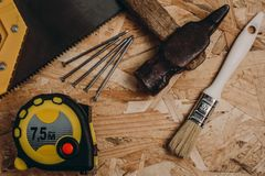 Construction tools on wooden surfase stock images