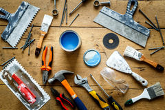 Construction tools on a wooden table with blue paint Royalty Free Stock Image
