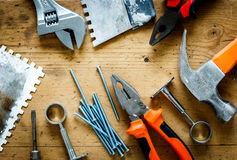 Construction tools on a wooden table Royalty Free Stock Images