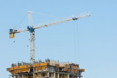 Construction tower crane. On going construction of a building with tower crane Stock Image