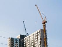 Construction tower crane near building. Stock Photos