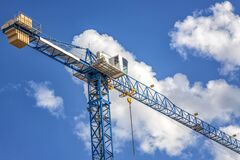Free Construction Tower Crane With A Cabin On Blue Sky Royalty Free Stock Photo - 176837365