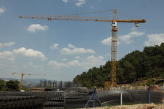Construction tower cranes and construction in forest Stock Photos