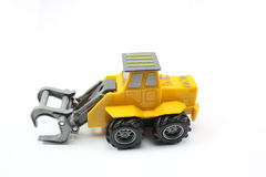 Construction toy truck. Claw construction toy truck on white background Royalty Free Stock Photography