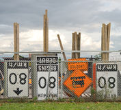 Construction traffic signs. Some construction traffic control signs behind a fence Stock Photos