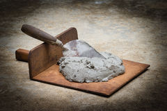 Construction trowel and mortar on ground Royalty Free Stock Photos