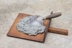 Construction trowel and mortar on ground Stock Photo