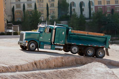 Construction truck. Sand gravel truck hauling load from lake Royalty Free Stock Photos