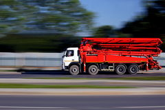 Construction truck with concrete pump machinery. On  way, transport and construction Stock Images