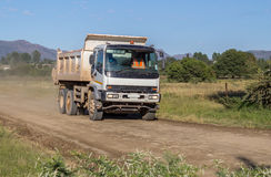 Construction truck moving fast with load of rock and sand on dir Stock Images