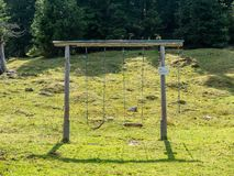 Construction of two swings in the landscape stock photos