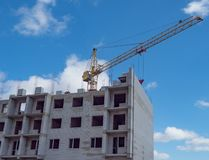 City new building multi-storey building construction crane brick open-air residential complex windows sky stock photo