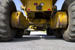 Construction vehicle. Yellow on street Royalty Free Stock Photo
