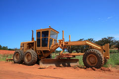 Construction vehicle. A construction vehicle on the field stock photos