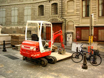 Construction vehicle. Renovating old buildings Stock Image