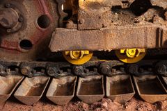 Construction Vehicle. Close up Wheeled Steel Tractor Track big heavy duty construction equipment, industrial series Stock Image