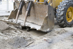 Construction vehicle in sand Royalty Free Stock Photo