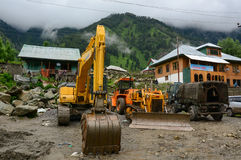 Construction vehicles on mountain road in Srinagar, India Stock Images