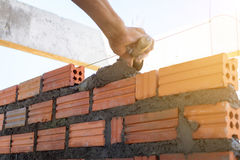 Construction wall Building with brick and cement stock photos