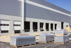 Construction of warehouse. Pallets on the construction site Stock Image