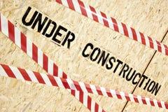 Construction warning on wood panels Royalty Free Stock Photo
