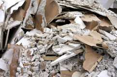 Construction waste background. Construction waste consists of unwanted material produced by the construction industry. Grey and whit colour. Abstract background Stock Photo