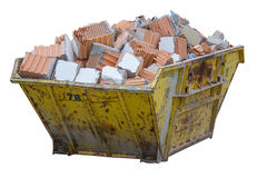 Construction waste container full of material from demolished wa Royalty Free Stock Image