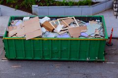 Construction waste in an metal container, home house renovation. Container for construction waste Stock Photos