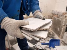 Construction waste and old tile in hand stock image