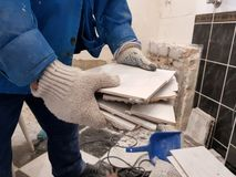 Construction waste and old tile in hand stock images