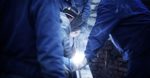 Construction Welder. The image is doark at the sides and good for copy space Royalty Free Stock Photos