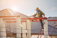 Welder workers installing steel frame structure of the house Stock Photography