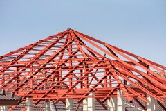 Welder workers installing steel frame structure of the house Royalty Free Stock Image
