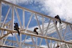 Construction welding workers. Three construction welders working high at a structure stock photos