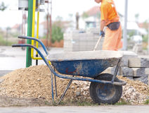 Construction wheelbarrow at building site Stock Images