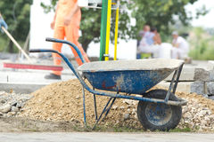 Construction wheelbarrow at building site Stock Photography
