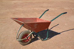 The construction wheelbarrow costs on the earth platform Royalty Free Stock Photos