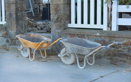 Construction wheelbarrow. Construction wheelbarrow standing at building site stock photos
