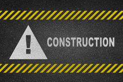 Construction white text on road Stock Images