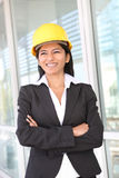 Construction Woman Architect. A pretty woman architect on the building construction site Stock Photo