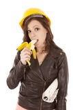 Construction woman eat banana Stock Photography