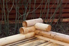 Construction of wooden arbor made of logs. Construction of the wooden arbor made of logs Royalty Free Stock Image