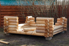 Construction of wooden arbor made of logs. Construction of the wooden arbor made of logs Stock Images