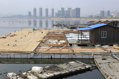 Construction of wooden barge. S, zhangzhou city, china. next to be built floating restaurant royalty free stock photos